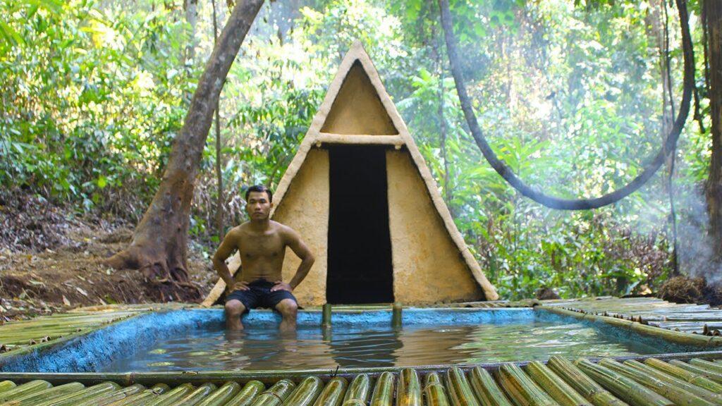 chalé e piscina feitos de materiais primitivos provam que a criatividade não tem limites.