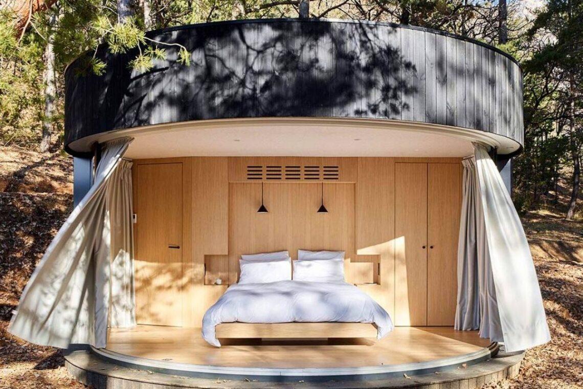 cabana de madeira circular lumipod foto 7