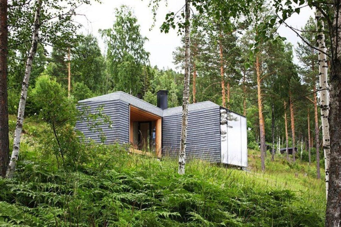 casa de madeira revestida em basalto atelier oslo foto 1