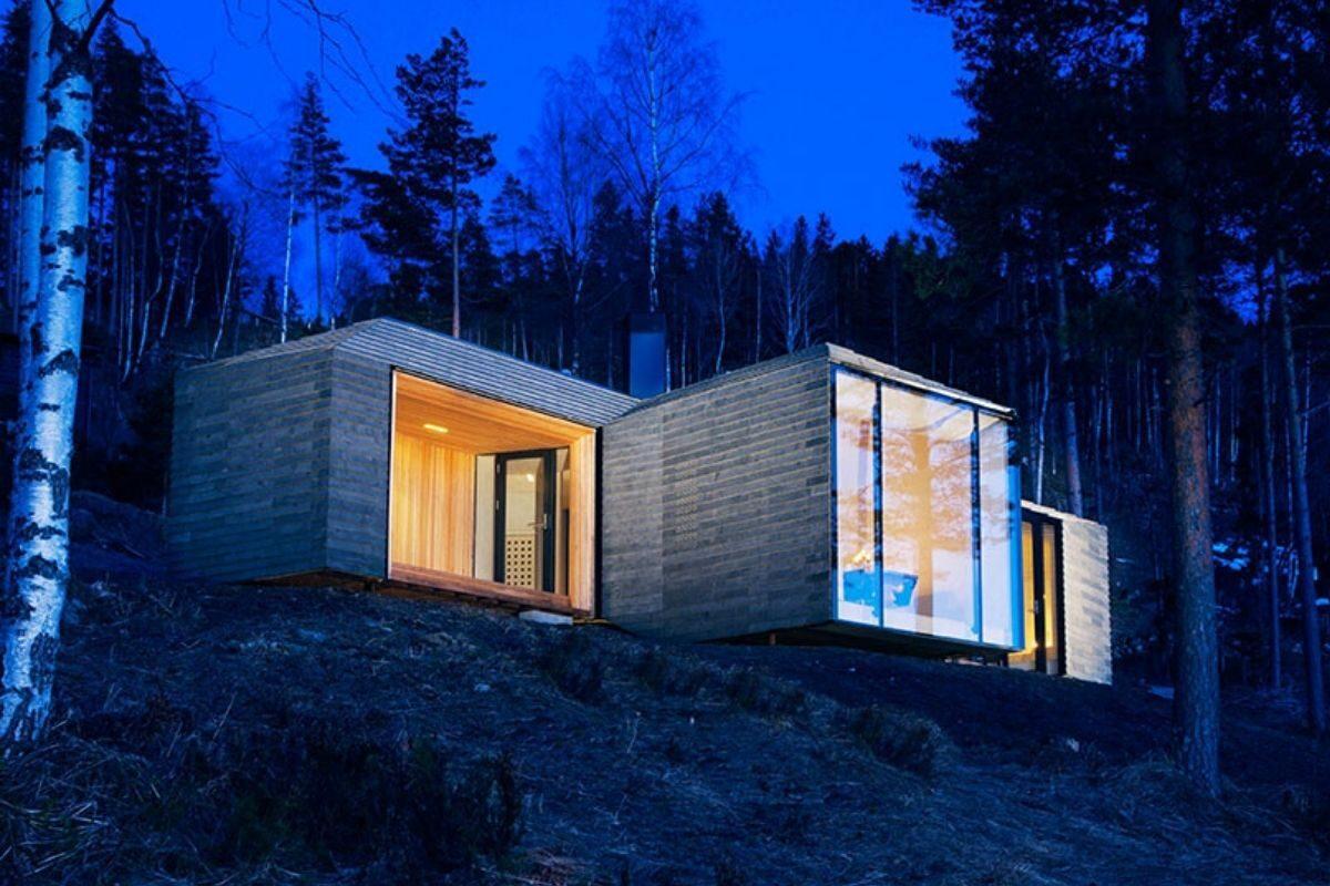 casa de madeira revestida em basalto atelier oslo foto 14
