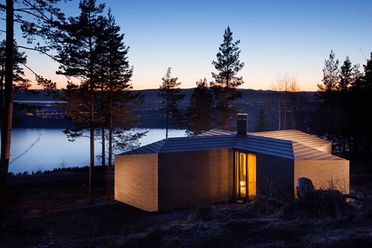 casa de madeira revestida em basalto atelier oslo foto 15