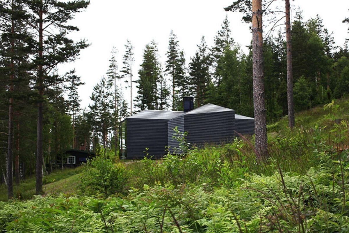 casa de madeira revestida em basalto atelier oslo foto 2