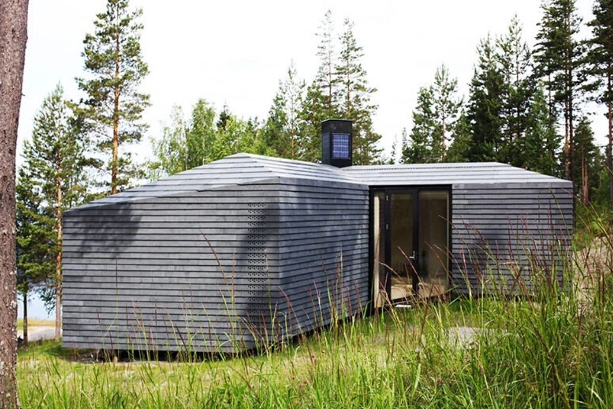 casa de madeira revestida em basalto atelier oslo foto 3