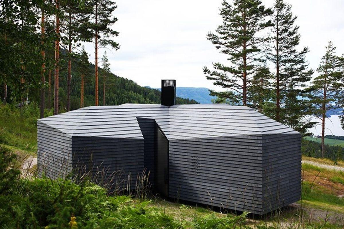 casa de madeira revestida em basalto atelier oslo foto 4