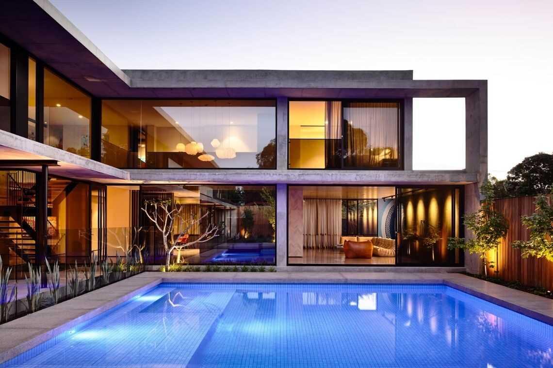 Casa em L de vidros